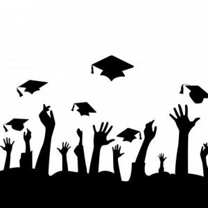 hands throwing mortar boards in air